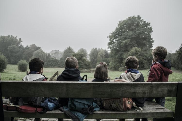 Children gathering outdoors.