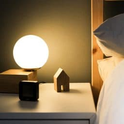 Photo of a nightstand next to a bed.